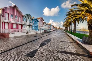 Colorful wooden striped facade of a typical Portuguese house at Aveiro, portuguese Venice, 10th Century city. old homes and houses in historic neighborhood, Portugal.