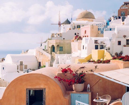 A vertical shot of beautiful buildings in Santorini island in the Aegean Sea, Cyclades, Greece