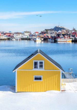 Yellow house on snow in fishing village at harbour